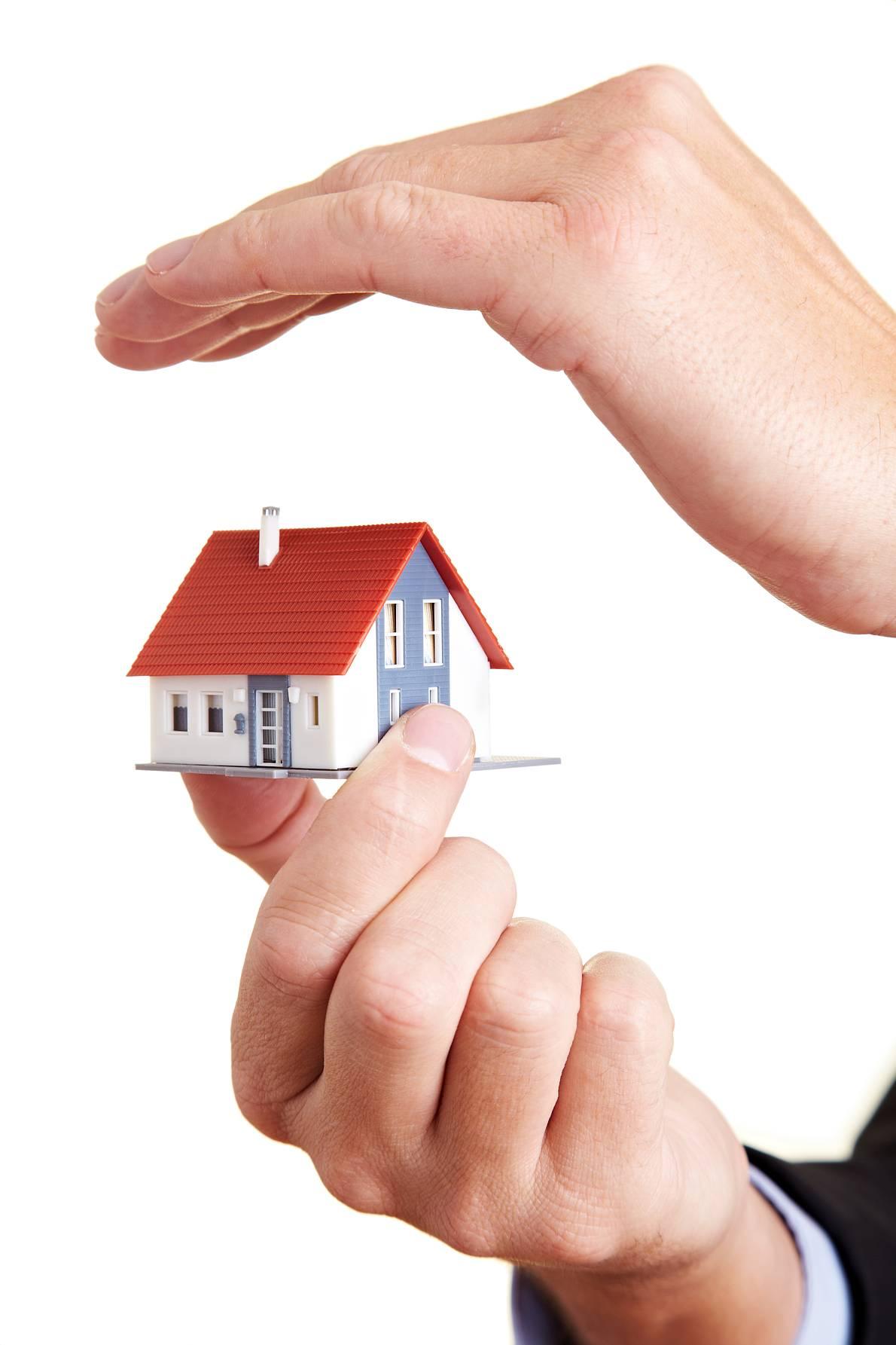 Eine Risikolebensversicherung ist beim Hausbau und immobilienerwerb sinnvoll Quelle: © Robert Kneschke - Fotolia
